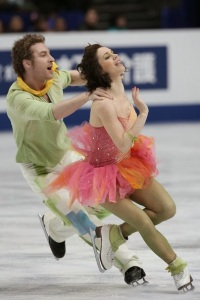 """France's Nathalie Péchalat and Fabian Bourzat wore these lime, orange, bubble gum pink, tan and yellow costumes on the podium to receive their bronze medal. They skated their free dance to """"The Little Prince and his rose."""""""